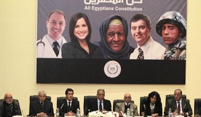 Egypt's constituent assembly Chairman Amr Moussa attends during a news conference in Cairo